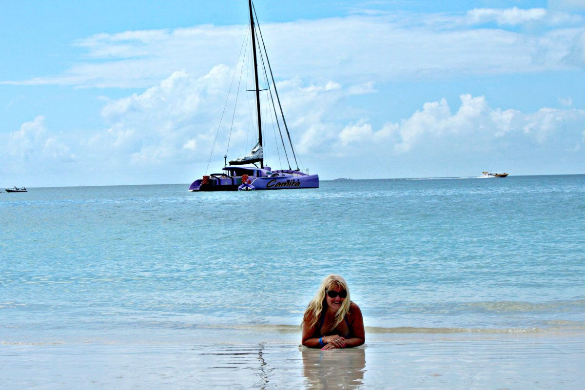 Lazing by the water's edge on Whitehaven Beach