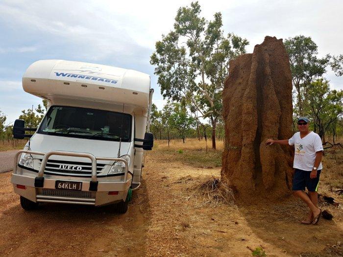 Motorhome parked beside huge termite mound