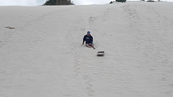 Sand boarding at Sandy Cape