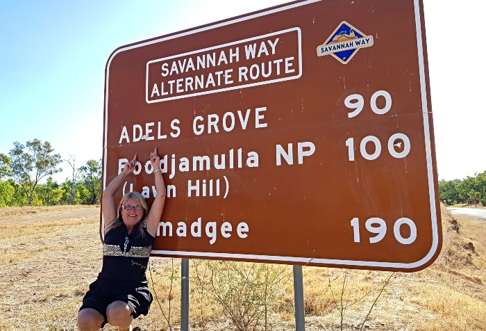 Adele under the Adels Grove sign