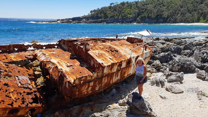 Checking out the shipwreck at Silica Beach