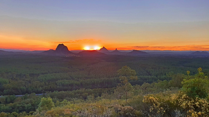 Watching the sun slowing sinking behind the Glasshouse Mountains from the Wild Horse Mountain Lookout