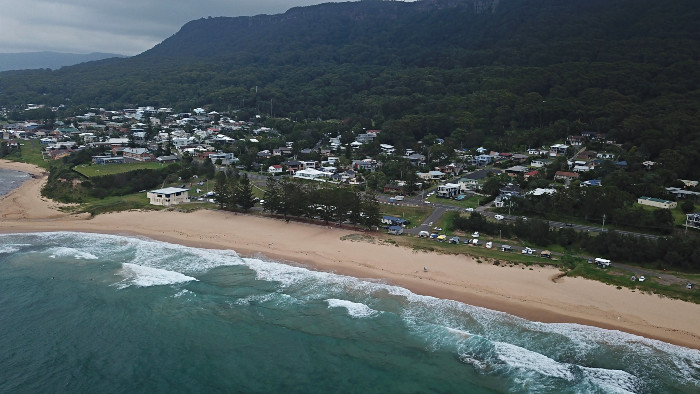 A drone view of Coledale Camping Reserve and Coledale Beach